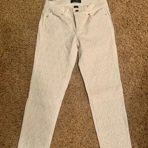 White jeans w/embroidering bead work.